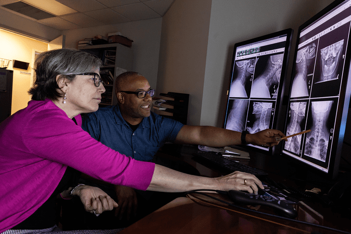 A radiologic technologist uses sophisticated equipment and technology.